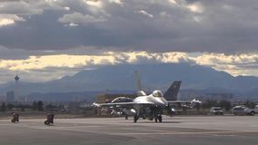 Taxing out to the runway two f-16 fighting falcon at red flag stock footage