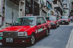 Taxis auf der Straße in Hong Kong stockbild