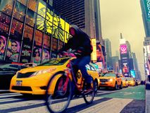Taxis and bicycle in the traffic of times square in Manhattan. New York City, USA - Apr 2018: Taxis and bicycle in the traffic of times square in Manhattan Stock Photos
