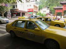 Taxis on Chinese City Street. Chinese taxis on a city street in Nanjing stock photography
