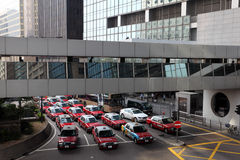 Taxis downtown in Hong Kong. Royalty Free Stock Image