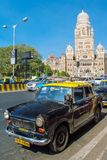 Taxis drive on a street in Mumbai, India Royalty Free Stock Photography