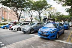 Taxis en la ciudad Singapur Imagen de archivo libre de regalías
