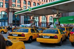 Taxis at a Gas Station. Taxis line up for gas at a BP in New York City Royalty Free Stock Photography
