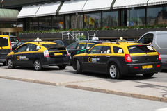 Taxis - hybrid and normal Stock Photos