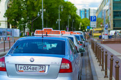 Taxis. KALININGRAD, RUSSIA - JUNE 27, 2015: taxi rank in the centre of the city on the Victory square. Cars are waiting for their customers Royalty Free Stock Photos