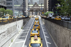 Taxis on Park Avenue Manhattan. Taxis emerge from Park Avenue Tunnel toward Grand Central Railroad Terminal in New York City on a sunny afternoon Royalty Free Stock Photos