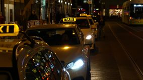 Night time video of taxis, trams, cars, cyclist and people in Rosenthaler Strasse, Berlin, Germany