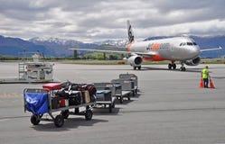 Taxis planos de Jetstar en el aeropuerto de Queenstown Imágenes de archivo libres de regalías