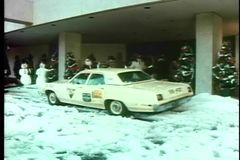 Taxis pulling up in front of hotel at Christmas time stock video