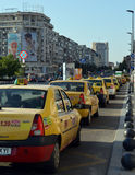 Taxis queue at taxi rank in Bucharest, Romania. Romanian taxis sit at a taxi rank at Piata Unirii (Unification Square) in the city centre of Bucharest, Romania royalty free stock photo