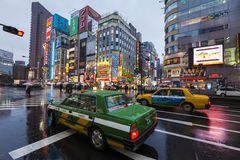 Taxis on rainy street in Shinjuku, Tokyo Royalty Free Stock Image