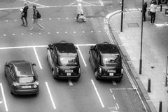 Taxis stopping on pedestrian crossing Stock Image