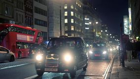 Taxis on The Strand at night