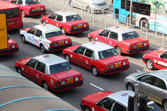 Taxis in the street of Hong Kong Stock Photography