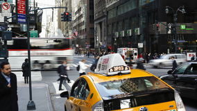 Taxis and street scene at intersection near grand central station manhattan stock footage