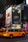 Taxis in Times Square, NYC. New York City taxi cabs pass through Times Square on a busy Friday night stock images