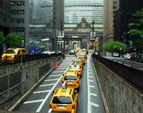 Taxis to Grand Central Terminal. Taxis emerge from Park Avenue Tunnel toward Grand Central Railroad Terminal in New York City on a rainy day Stock Image