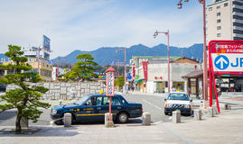 Taxis are waiting for tourists in front of Miyajima pier. Royalty Free Stock Images