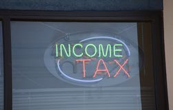 Taxpayer Income Tax Taxation. An income tax is a tax imposed on individuals or entities that varies with respective income or profits. Income tax generally is royalty free stock photo