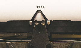 Taxus, portugiesischer Text für Steuer auf Weinleseart Verfasser ab 1920 s Lizenzfreie Stockfotos