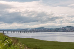 Tay Bridge Accross Green Fields Dundee Scotland. The Tay Road Bridge serving Dundee and the East Coast of Scotland Royalty Free Stock Photo