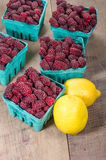 Tayberries and lemons for cooking Royalty Free Stock Photo