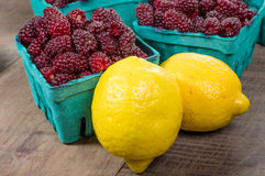 Tayberries and lemons for cooking Stock Photo