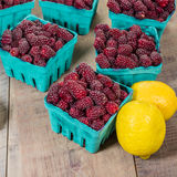 Tayberries and lemons for cooking Royalty Free Stock Images