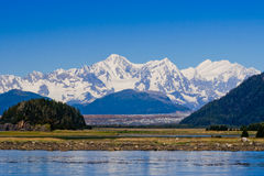 Taylor Bay Alaska. Beautiful Snow-capped mountains and blue sky reflected in the water of Taylor Bay Alaska Stock Image