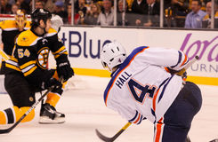 Taylor Hall puts a shot on the Bruins. Stock Photography