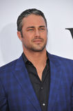 Taylor Kinney. LOS ANGELES, CA - APRIL 21, 2014: Taylor Kinney at the Los Angeles premiere of his movie The Other Woman at the Regency Village Theatre, Westwood Stock Image
