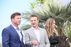 Taylor Sheridan, Jeremy Renner and Elizabeth Olsen Stock Photos