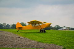 Taylorcraft L-2. American reconnaissance aircraft in World War II. Painted yellow for exhibition. L2 museum airplane transport paratroopers 101 division france royalty free stock photo