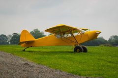 Taylorcraft L-2. American reconnaissance aircraft in World War II. Painted yellow for exhibition. L2 museum airplane transport paratroopers 101 division france stock photo