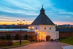 The Taynitskaya tower of the Kazan Kremlin. The illuminated Taynitskaya tower of the Kazan Kremlin at night with sunset sky Royalty Free Stock Photo