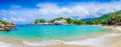 TAYRONA, COLOMBIA OCTOBER 20, 2017: Panoramic view of unidentified people enjoying the beautiful beach, turquise water. And blue sky at Cabo San Juan, Tayrona Stock Photography