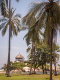 Tayrona Hut Through Palm Trees Royalty Free Stock Photography