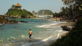 TAYRONA NATIONAL PARK, COLOMBIA - People enjoy their vacations at the sand beach of Cabo San Juan de Guía.