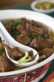 Tazón de fuente asiático 4 de los tallarines de la carne de vaca Imagen de archivo libre de regalías