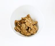 Tazón de fuente con los copos de maíz Imagen de archivo libre de regalías