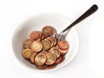 Tazón de fuente, cuchara y dinero Foto de archivo libre de regalías