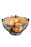 Tazón de fuente de fruta del metal y cocos Foto de archivo