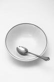 Tazón de fuente de la cuchara y de cereal vacío Fotos de archivo