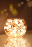 Tazón de fuente de la luz de la Navidad Foto de archivo