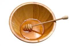 Tazón de fuente de la miel de oro Fotos de archivo libres de regalías