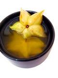 Taza amarilla 1 del negro de la fruta de estrella Imágenes de archivo libres de regalías