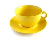 Taza amarilla Imagenes de archivo