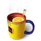 Taza amarilla de té Imagenes de archivo