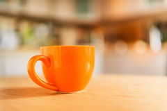Taza anaranjada Imagen de archivo libre de regalías